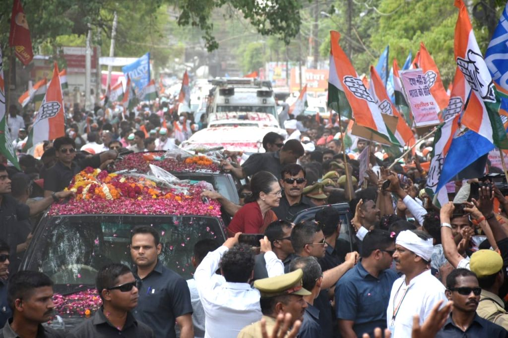 Rae Bareilly: UPA Chairperson and Congress's Lok Sabha candidate from Rae Bareilly, Sonia Gandhi during a roadshow ahead of filing her nomination for the 2019 Lok Sabha elections, in Uttar Pradesh's ... - Sonia Gandhi