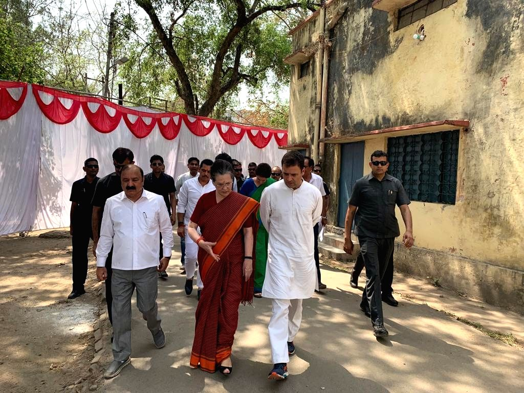 Rae Bareilly: UPA Chairperson and Congress's Lok Sabha candidate from Rae Bareilly, Sonia Gandhi with his son and party President Rahul Gandhi ahead of filing her nomination for the 2019 Lok Sabha ... - Sonia Gandhi and Rahul Gandhi
