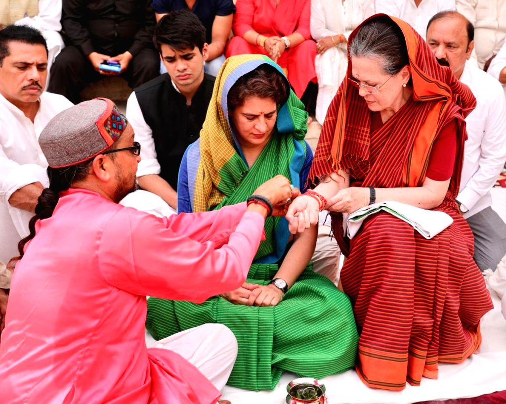 Rae Bareilly: UPA Chairperson and Congress's Lok Sabha candidate from Rae Bareilly, Sonia Gandhi with her daughter and party's General Secretary (Uttar Pradesh East) Priyanka Gandhi Vadra and son-in-law Robert Vadra, during a 'Havan' organised at the - Sonia Gandhi and Priyanka Gandhi Vadra