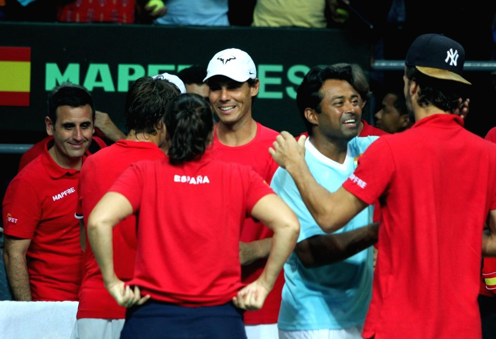 Rafael Nadal of Spain and India's Leander Paes during Davis Cup World Group Play-off match at RK Khanna Tennis Stadium in New Delhi on Sept 18, 2016. Spain won.