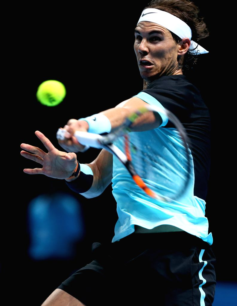 Rafael Nadal of Spain returns the ball during the match against Stan Wawrinka of Switzerland at the ATP World Tour Finals at the O2 Arena in London, Britain, Nov. ...