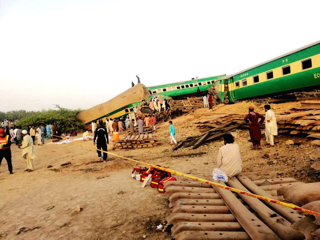 RAHIM YAR KHAN, July 11, 2019 (Xinhua) -- Photo taken with a mobile phone shows people and rescuers working at the train accident site in Pakistan's eastern city of Rahim Yar Khan on July 11, 2019. A passenger train rammed into a freight train in Pak - Rahim Yar Khan