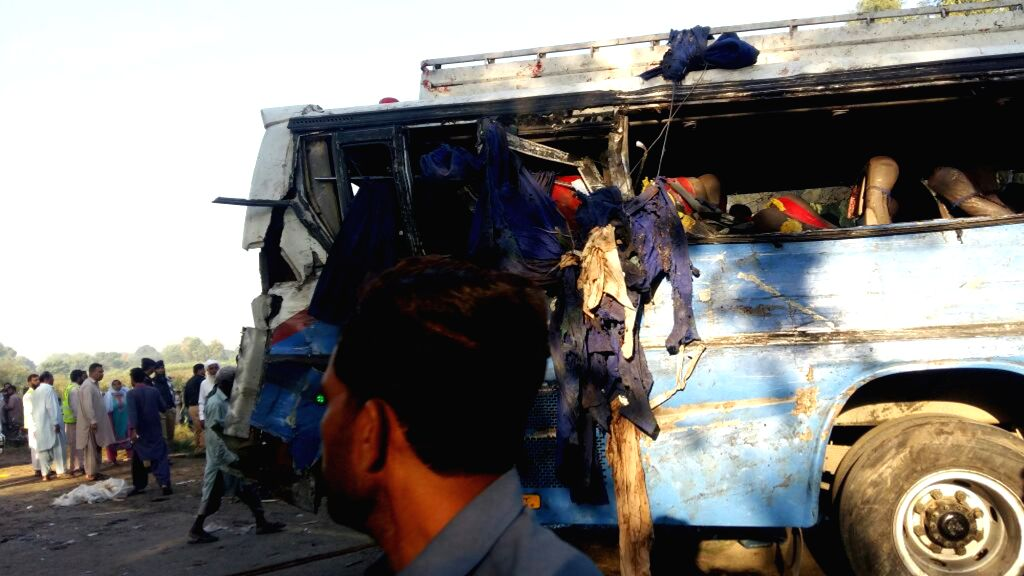 RAHIM YAR KHAN, Oct. 17, 2016 - Local people gather at the accident site in eastern Pakistan's Rahim Yar Khan on Oct. 17, 2016. At least 27 people were killed and over 50 others injured when two ... - Rahim Yar Khan