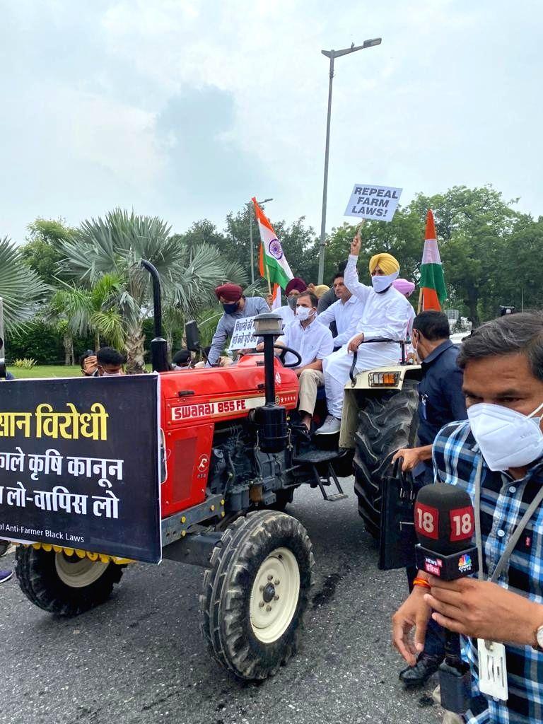 Rahul Gandhi in tractor towards parliament opposing farm laws. - Rahul Gandhi