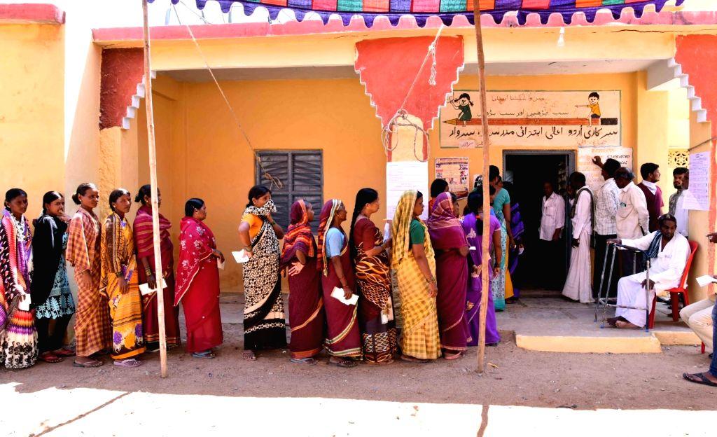 Raichur: People wait in queue to cast vote during the third phase of Lok Sabha polls, in Raichur, Karnataka on April 23, 2019. (Photo: IANS)