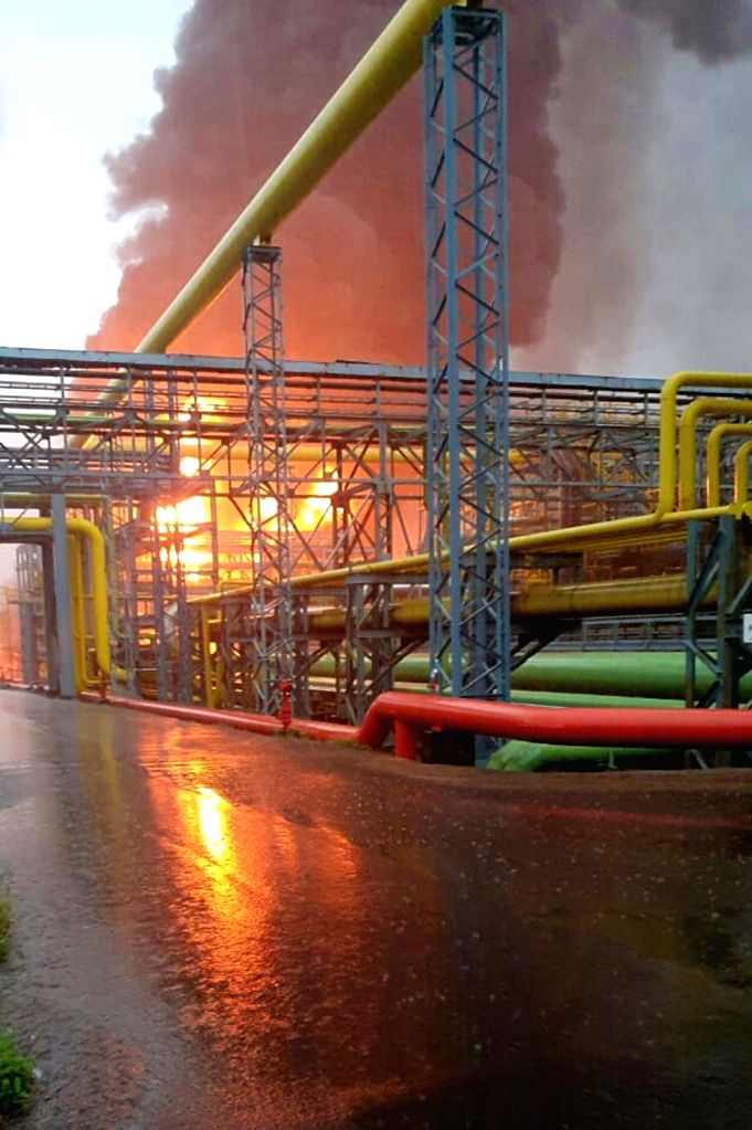 Raigad (Maharashtra) : Massive fire breaks out in a storm water drainage network at ONGC's oil and gas processing plant in Uran in Navi Mumbai, on Sep 3, 2019. Four persons were killed so far and ...