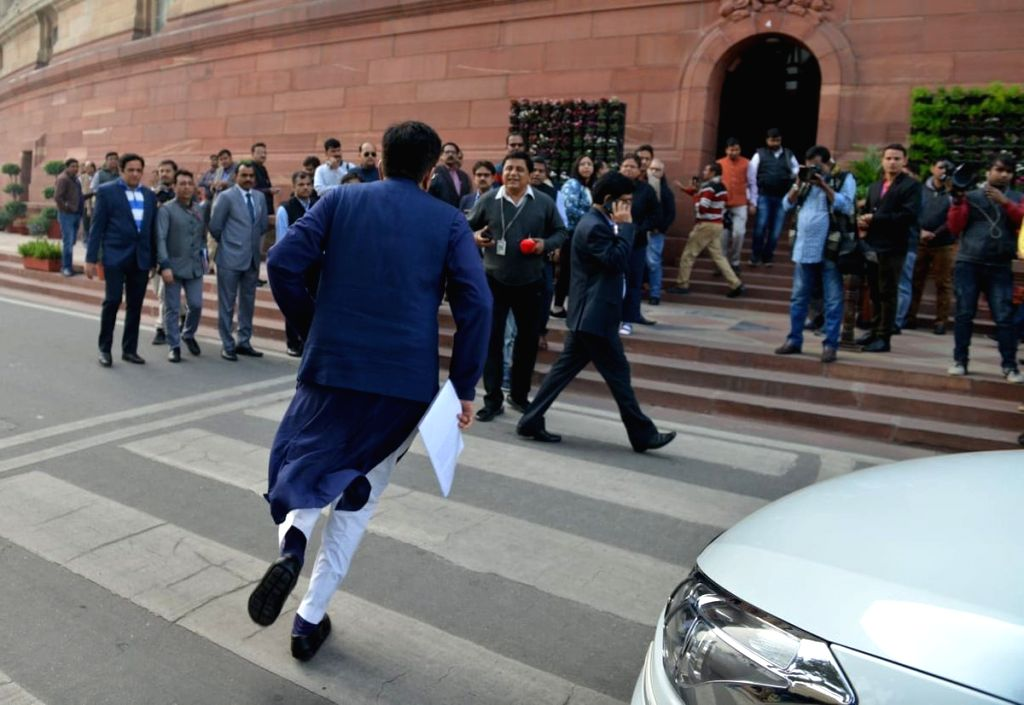 Railway Minister Piyush Goyal's picture while rushing to Parliament to field questions from members went viral on Twitter, with users praising him. A Twitter user posted the picture and posted: ... - Piyush Goya