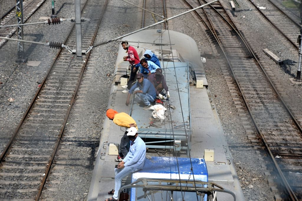 Railway workers engaged in their day-to-day chores at the Patna Junction Railway Station during the extended nationwide lockdown imposed to mitigate the spread of coronavirus; on Apr 26, 2020.
