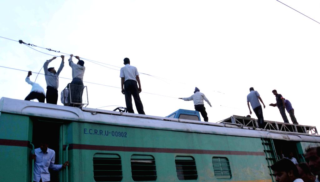 Railway workers repair the overhead wires that were destroyed after Maoists triggered an explosion between Ismailpur and Rafiganj section of Bihar on the intervening night of 22-23 July 2014. The ...