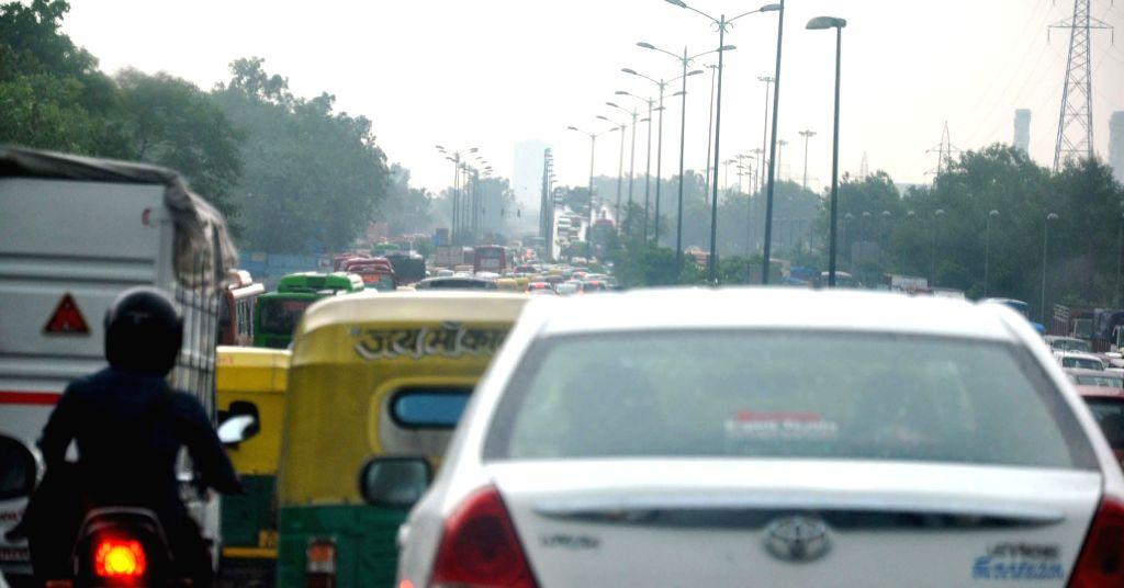 Rain in Delhi and traffic jam due to rain near sarai kale kahn in Delhi on Aug 30, 2014.