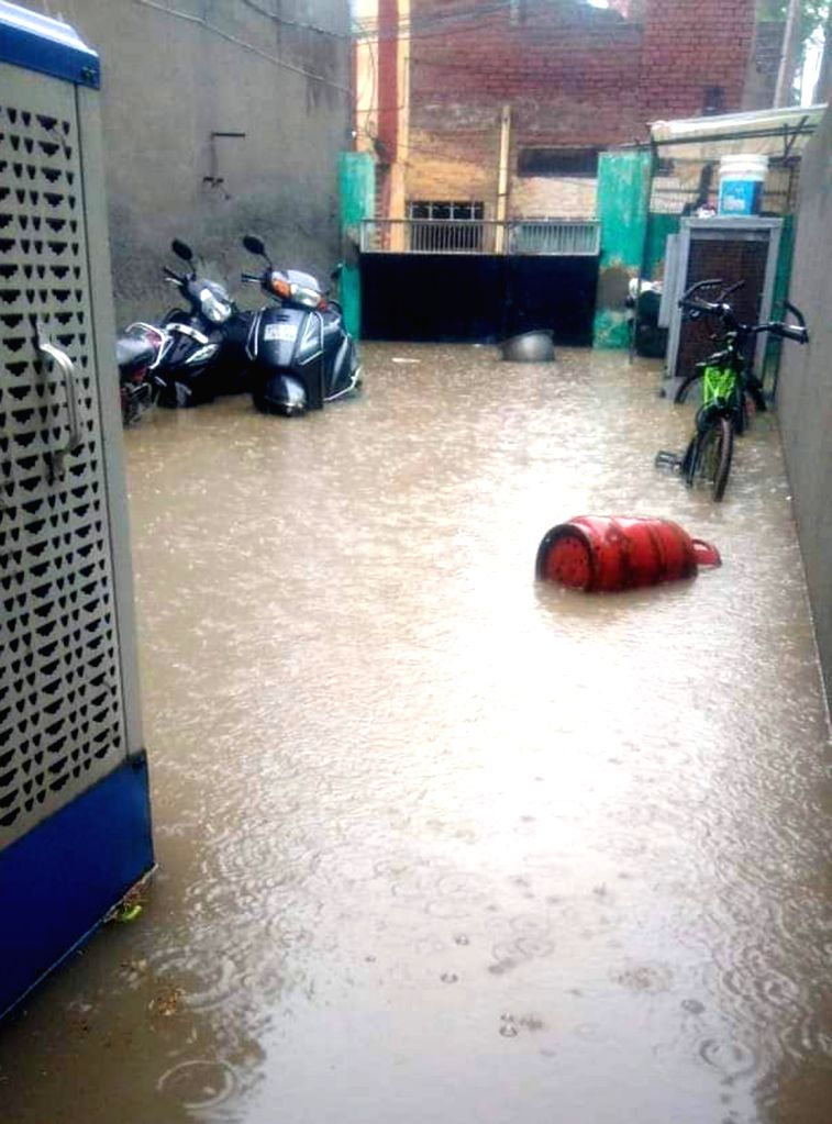 Rain water inundates a house in Punjab's Bathinda, on July 16, 2019.