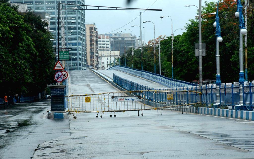 Rain wet deserted road during heavy rain and lockdown on Coronavirus pandemic in Kolkata on May 26, 2021