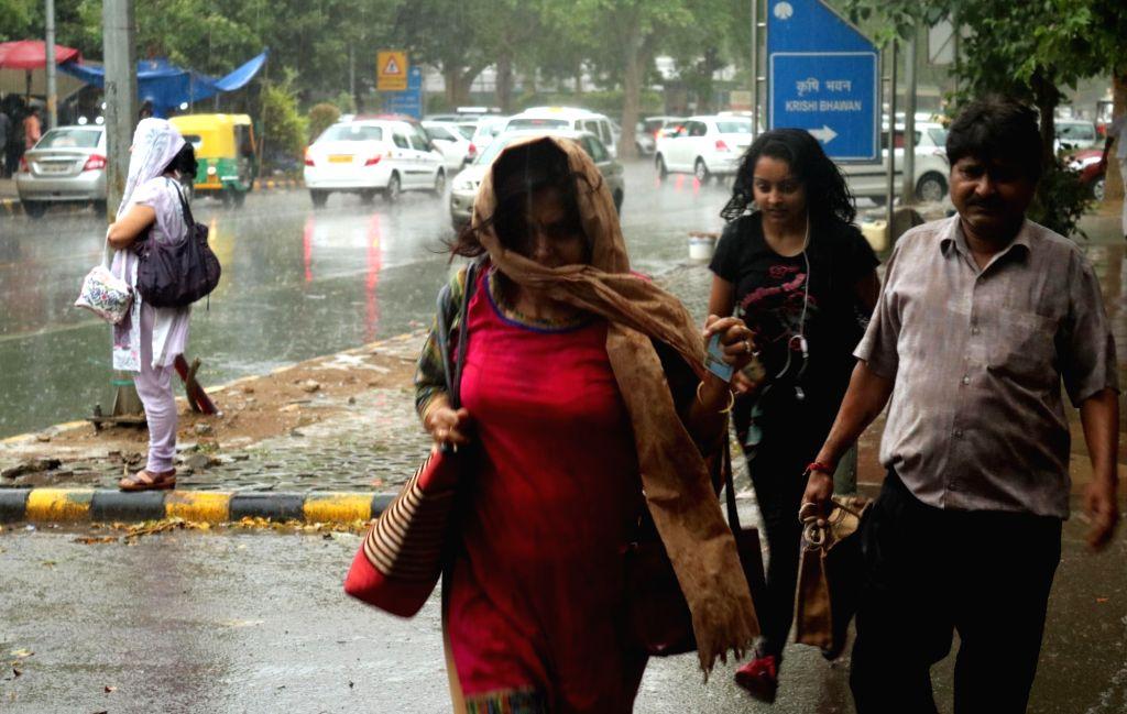 Rains lash New Delhi, on May 23, 2016.