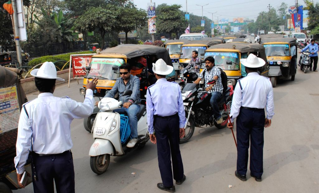 Raipur, Chhattisgarh, India, Wednesday, 2 Jan, 2013, Traffic Police fined to overload auto and vehicles on the first day of Police Road Safety Week at Raipur. ImagesMart.co/Anwar Qureshi