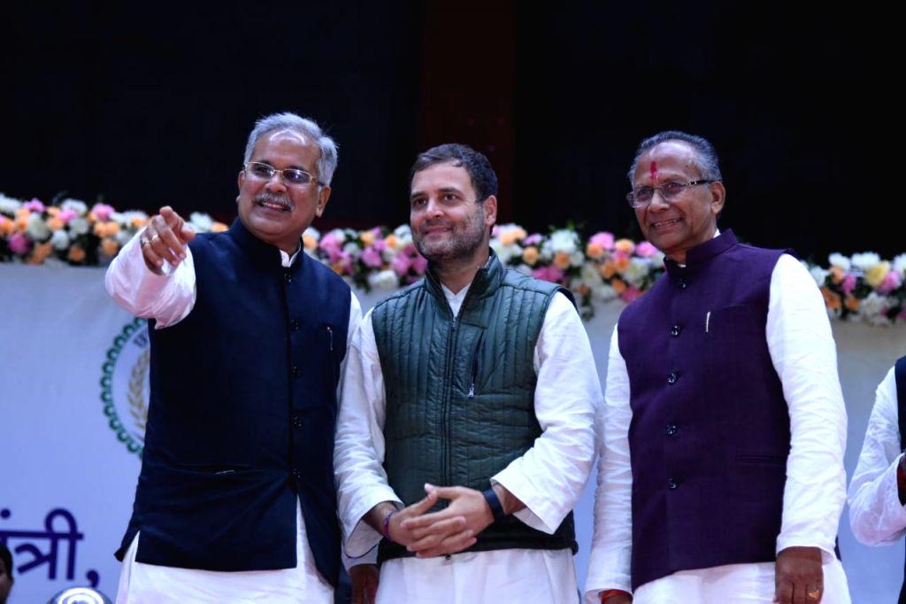 Raipur: Newly sworn-in Chhattisgarh Chief Minister Bhupesh Baghel with Congress leaders Rahul Gandhi and Tamradhwaj Sahu at his swearing-in ceremony in Raipur, on Dec 17, 2018. (Photo: IANS) - Bhupesh Baghel and Rahul Gandhi
