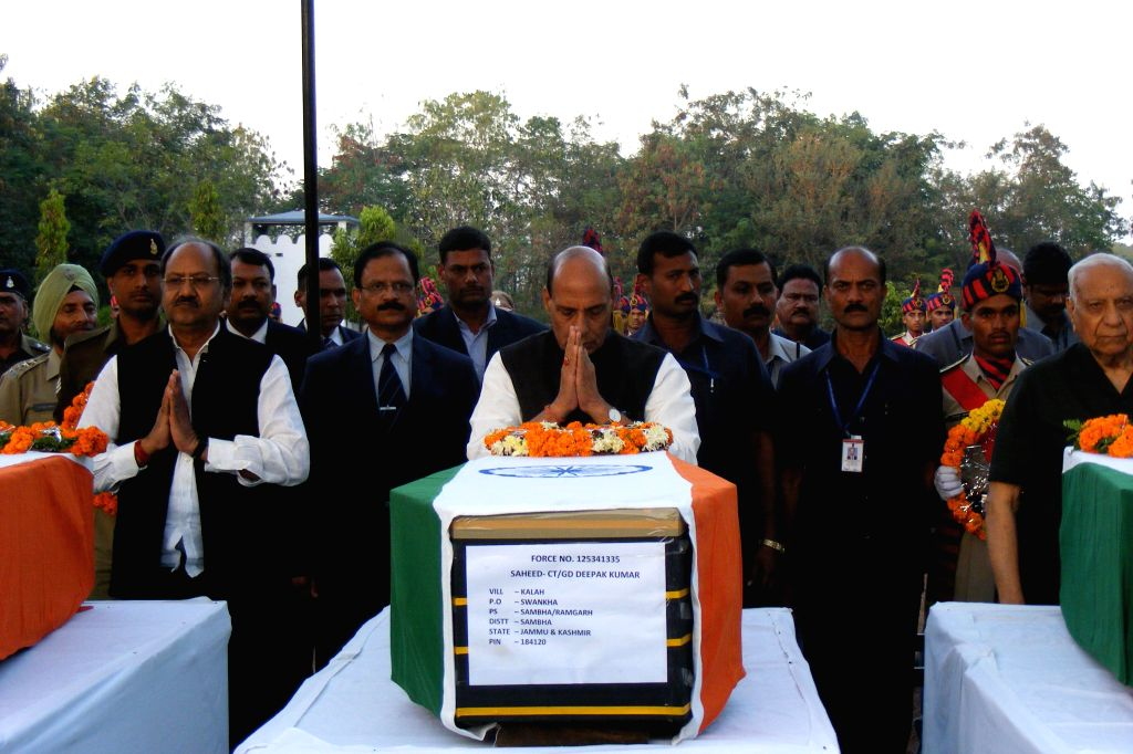 Union Home Minister Rajnath Singh pays tribute to the 13 CRPF troopers gunned down by Maoists on Monday (1st December) in a thickly forested area of Chhattisgarh, on Dec 2, 2014.