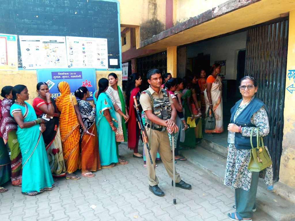 Raipur: Voters wait in a queue outside a polling booth to cast their votes during the second and concluding phase of Chhattisgarh Assembly elections at Kukurbeda in Raipur, on Nov 20, 2018. (Photo: IANS)
