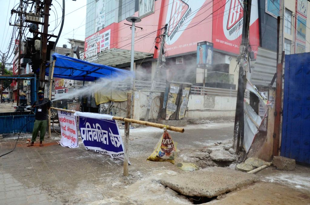 Raja Bazar in Patna's Khajpura being sanitised after it was sealed following one person in the locality testing positive for COVID-19, during the extended nationwide lockdown imposed to ...