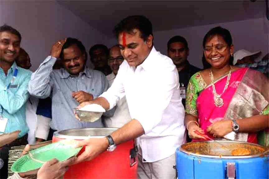 Rajanna Sircilla: TRS Working President KT Rama Rao serves food to people after launching 'Rs 5 Annapurna Bhojanam scheme' in Telangana's Rajanna Sircilla district, on Feb 8, 2019. - Rao
