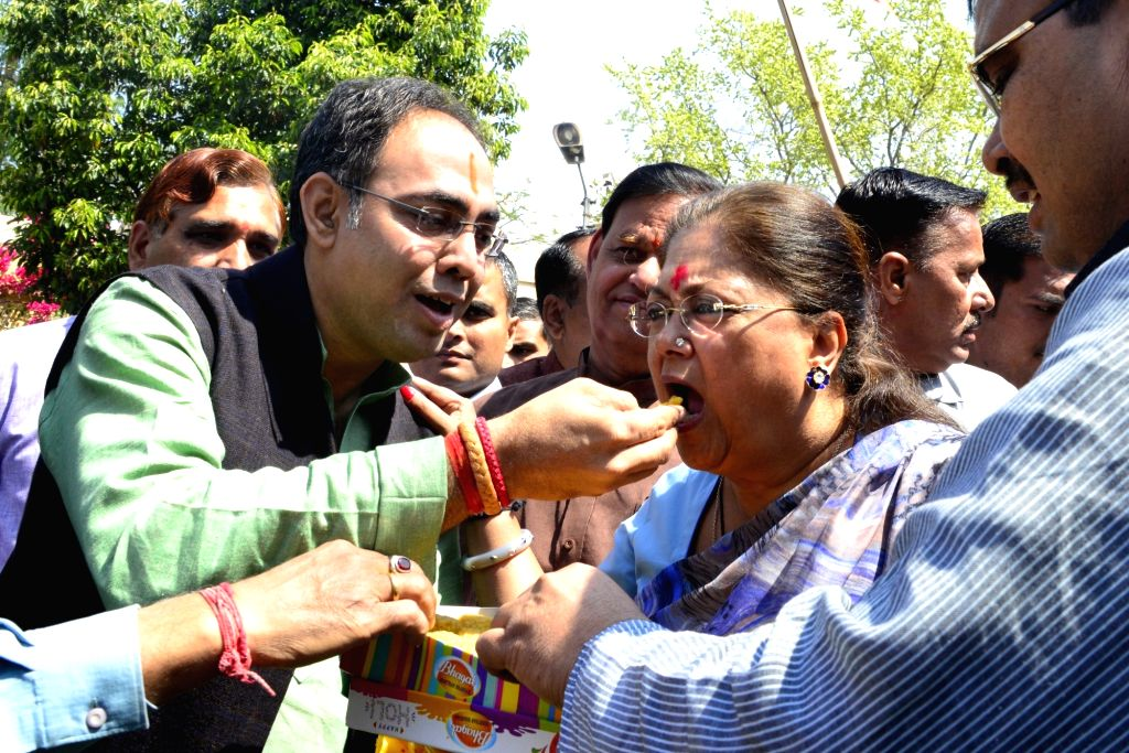 Rajasthan Chief Minister and BJP leader Vasundhara Raje with party workers celebrate party's performance in the assembly elections in Jaipur on March 11, 2017.