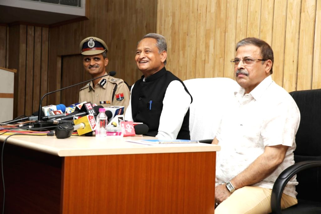 Rajasthan Chief Minister Ashok Gehlot accaompanied by state DGP Bhupendra Singh,  addresses a press conference at the police headquarters in Jaipur on Sep 4, 2019. - Ashok Gehlot and Bhupendra Singh