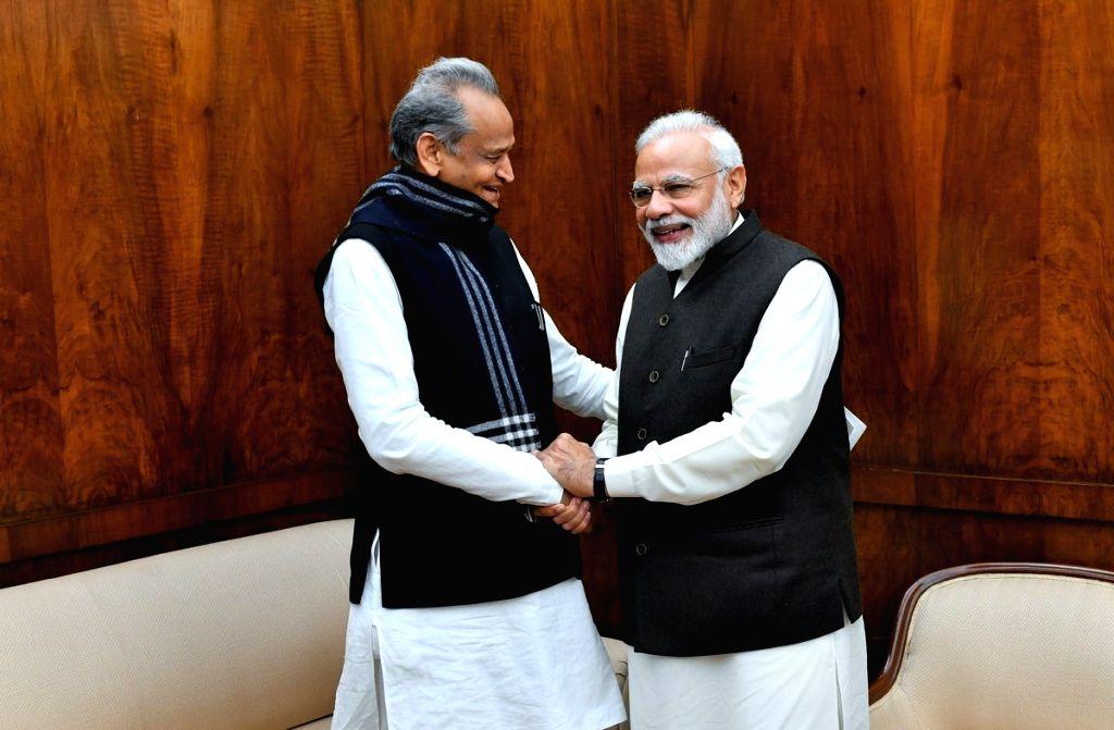 Rajasthan Chief Minister Ashok Gehlot calls on Prime Minister Narendra Modi in New Delhi. - Ashok Gehlot and Narendra Modi