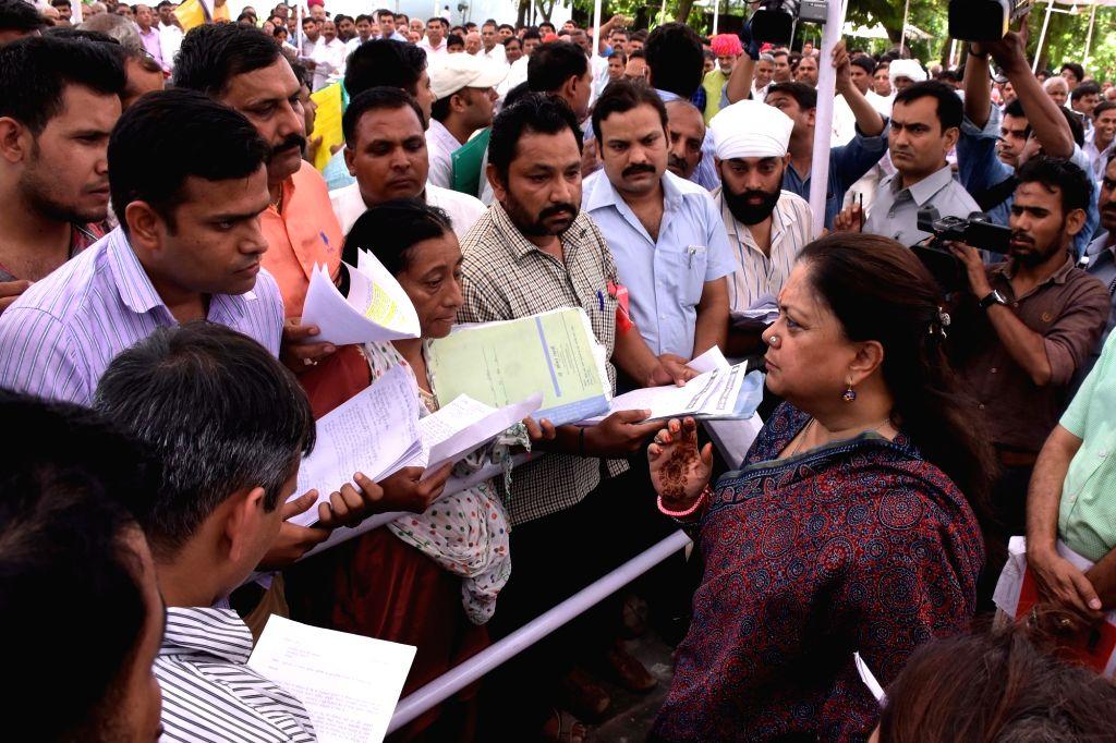 Rajasthan Chief Minister Vasundhara Raje interacts with people at her residence in Jaipur, on Sept 9, 2016. - Vasundhara Raje