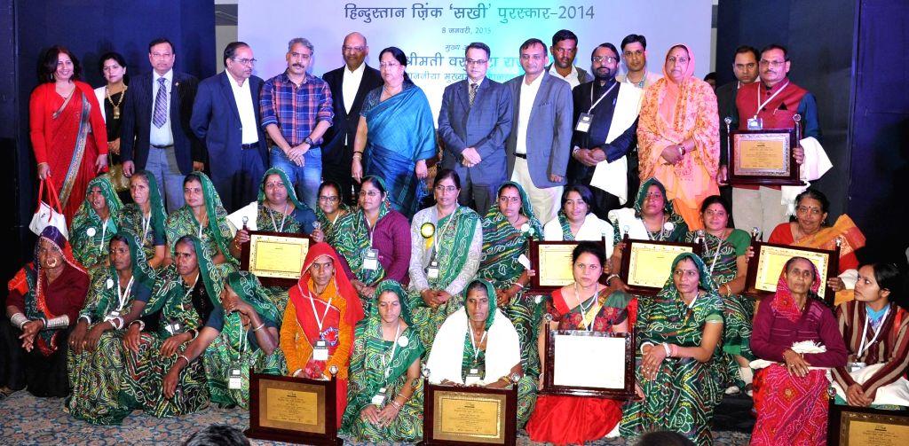 Rajasthan Chief Minister Vasundhara Raje, Vedanta Group Chairman Anil Agarwal and other dignitaries during Hindustan Zinc `SAKHI` awards in Jaipur. - Vasundhara Raje