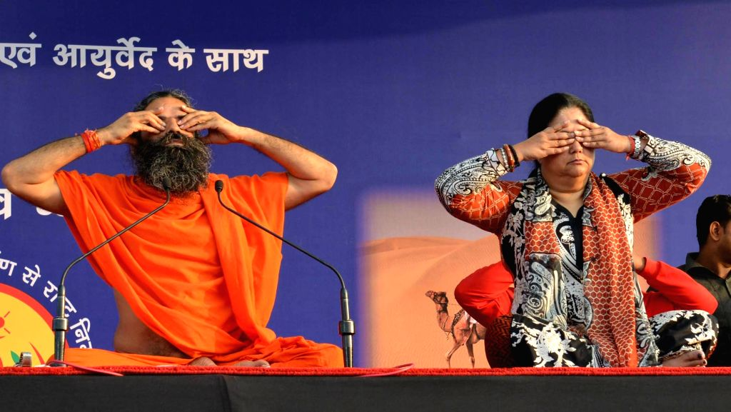 Rajasthan Chief Minister Vasundhara Raje with Baba Yoga guru Ramdev participate during a Yoga session in Jaipur on Oct 31, 2015.