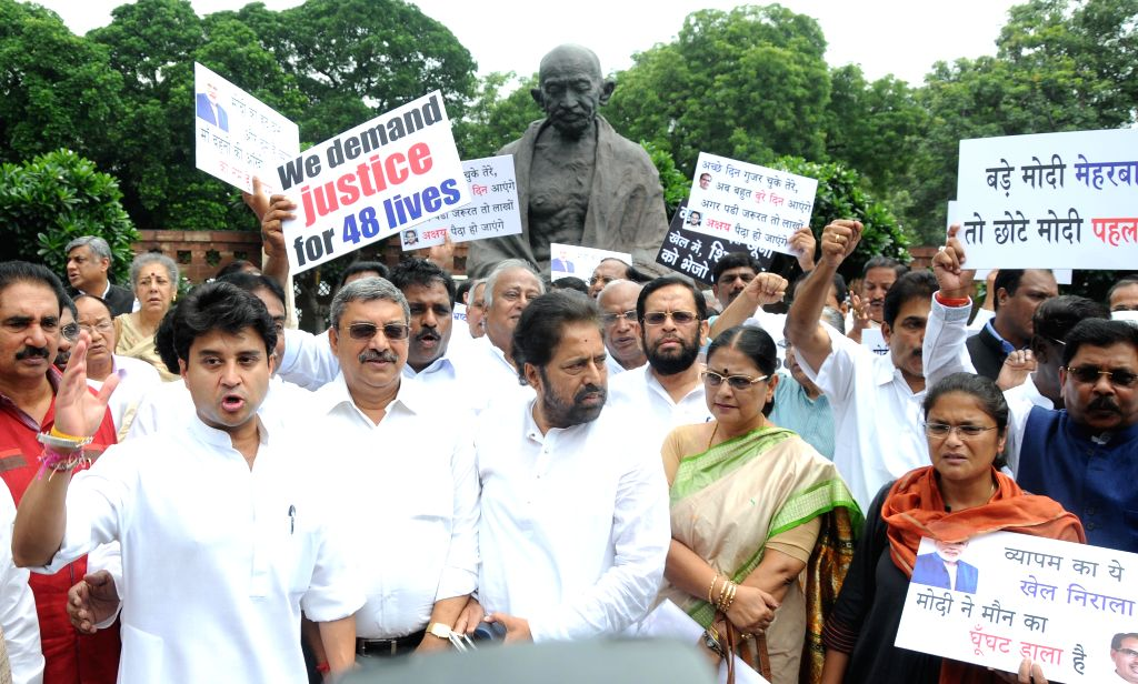 Rajasthan Congress chief Sachin Pilot, Trinamool Congress MPs Sudip Bandyopadhyay and other parliamentarians stage a demonstration at the Parliament  in New Delhi, on Aug 13, 2015.