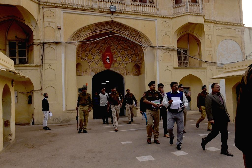 Rajasthan Director General (prisons) NRK Reddy, accompanied by senior officers coming out from the entrance gate of Jaipur central jail where a Pakistani prisoner allegedly murdered by group ...