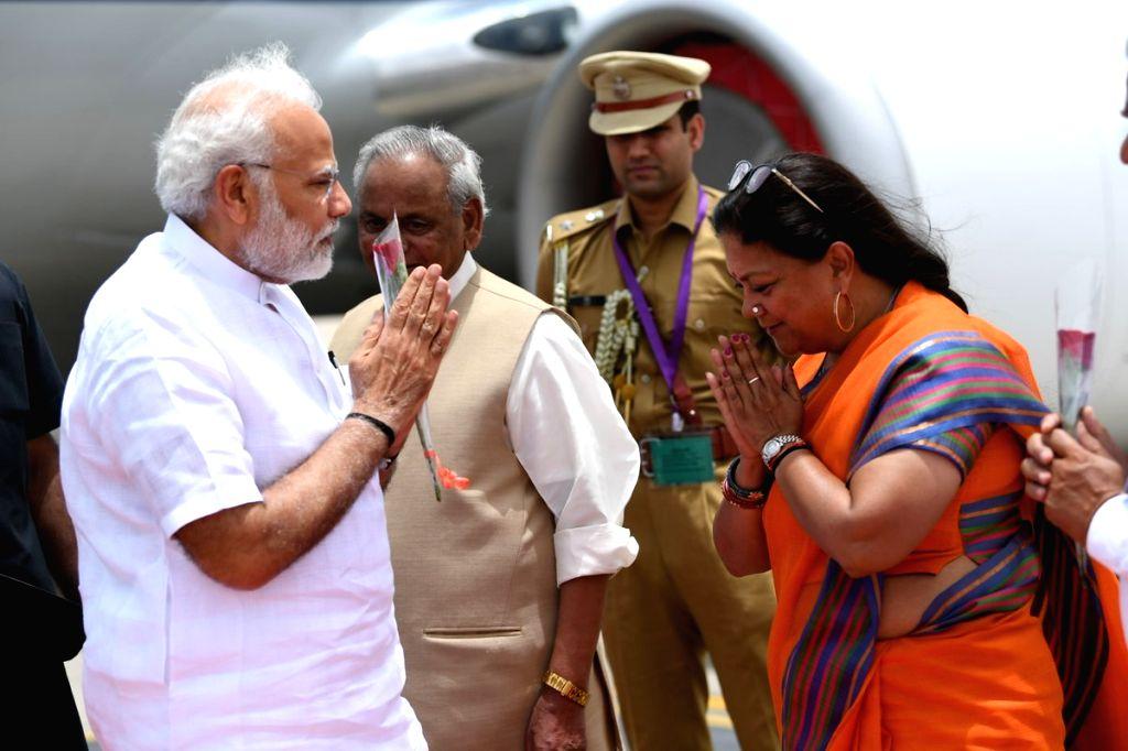 Rajasthan Governor Kalyan Singh and Chief Minister Vasundhara Raje receive Prime Minister Narendra Modi on his arrival in Jaipur on July 7, 2018. - Vasundhara Raje, Narendra Modi and Kalyan Singh