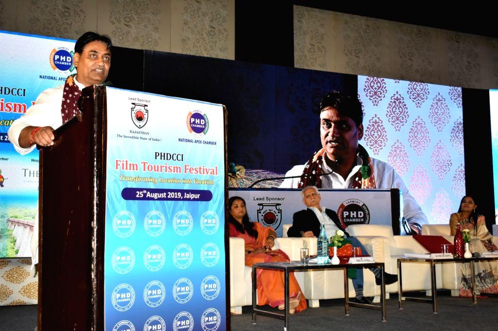 Rajasthan Minister of State for Tourism Govind Singh Dotasra addresses during the PHDCCI Film Tourism Festival at Hotel Clarks Amer, in Jaipur on Aug 25, 2019. - Govind Singh Dotasra