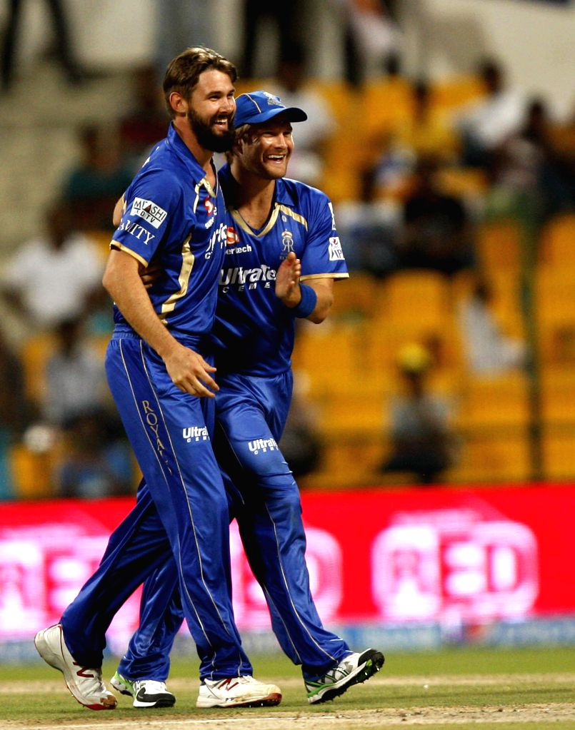 Rajasthan Royals players Kane Richardson and Shane Watson celebrate fall of a wicket during the fourth match of IPL 2014 between Sunrisers Hyderabad and Rajasthan Royals, played at Sheikh Zayed ...