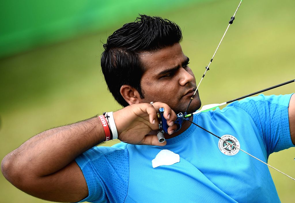 :Rajat Chauhan of India competes during the compound men's team gold medal match of archery competition against South Korea at the 17th Asian Games in ...