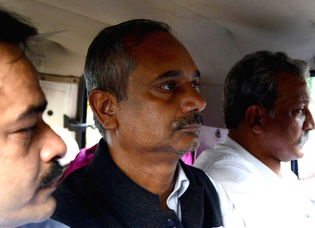Rajendra Kumar, Principal Secretary of Delhi Chief Minister Arvind Kejriwal being taken away by CBI officials after produced at Patiala House Court in a corruption case in New Delhi on ... - Arvind Kejriwal and Rajendra Kumar