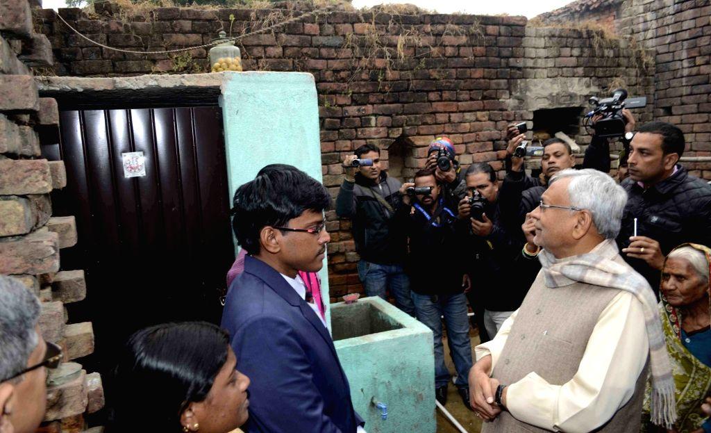 Rajgir: Bihar Chief Minister Nitish Kumar inspects open defecation free houses of Rajgir in Nalanda district of Bihar on Dec 29, 2016. (Photo: IANS) - Nitish Kumar