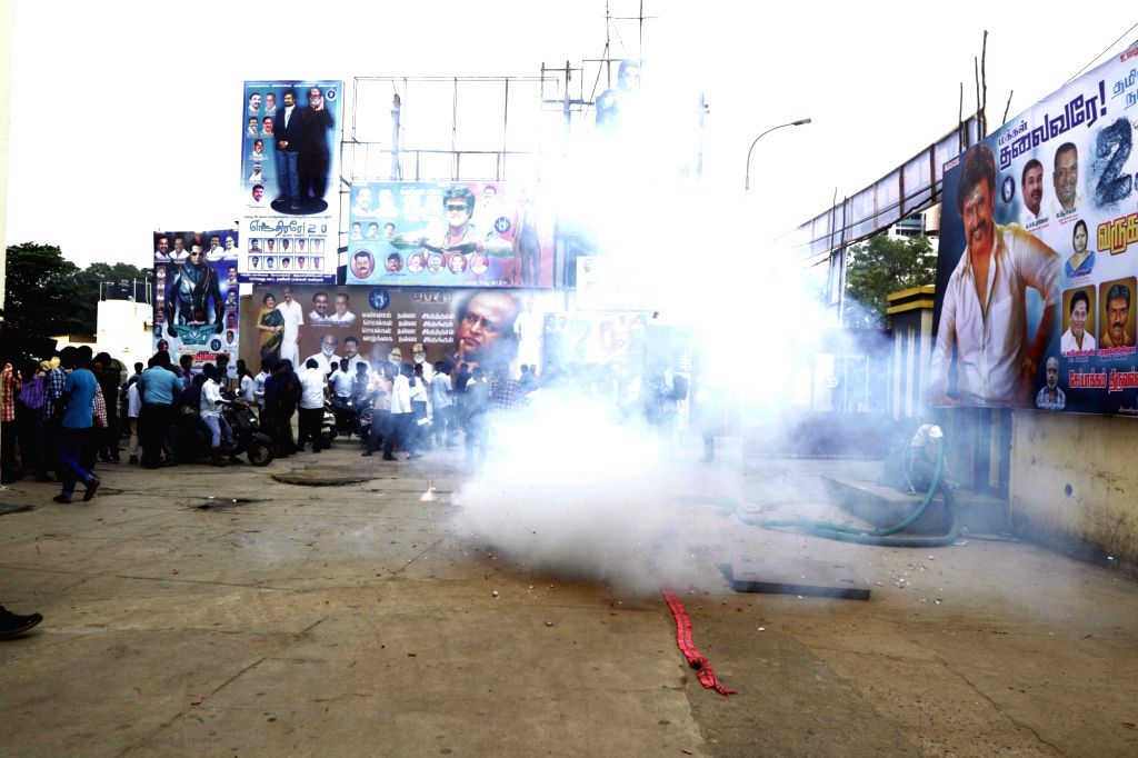 """Rajinikanth fans burst crackers to celebrate the release of his film """"2.0"""" in Chennai, on Nov 29, 2018."""
