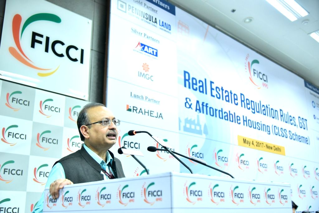 """Rajiv Ranjan Mishra, Joint Secretary in the Ministry of Housing and Urban Poverty Alleviation addresses during a seminar on """"Real Estate Regulation Rules, GST & Affordable Housing ... - Rajiv Ranjan Mishra"""
