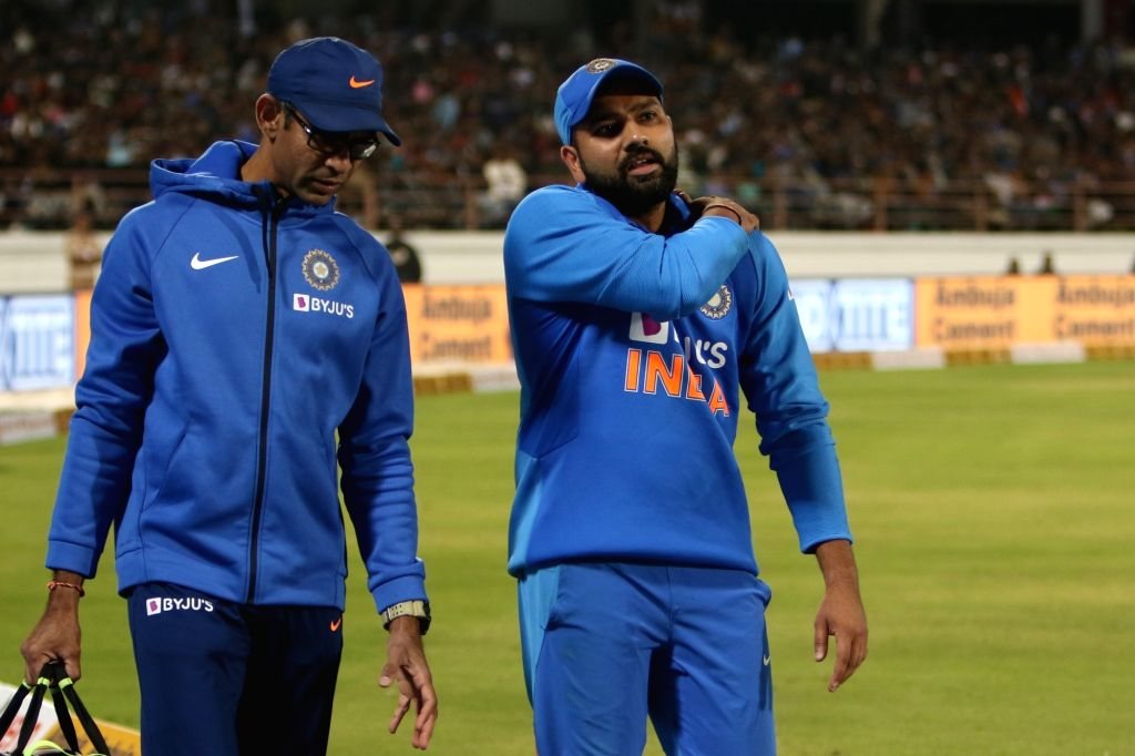 Rajkot: India's Rohit Sharma walks back to the pavilion after getting injured during the second ODI of the three-match series between India and Australia, at Saurashtra Cricket Association Stadium in Gujarat's Rajkot on Jan 17, 2020. (Photo: Surjeet  - Rohit Sharma and Surjeet Yadav