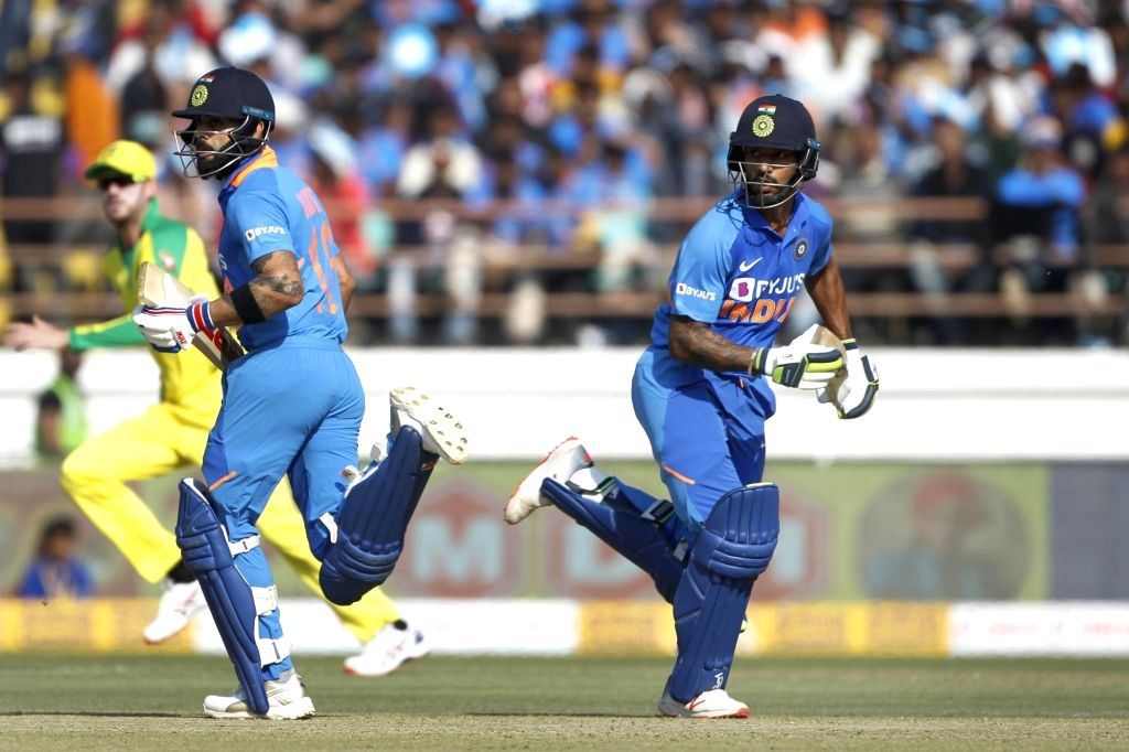 Rajkot: India's Shikhar Dhawan and Virat Kohli run between the wickets during the second ODI of the three-match series between India and Australia, at Saurashtra Cricket Association Stadium in Gujarat's Rajkot on Jan 17, 2020. (Photo: Surjeet Yadav/I - Shikhar Dhawan, Virat Kohli and Surjeet Yadav