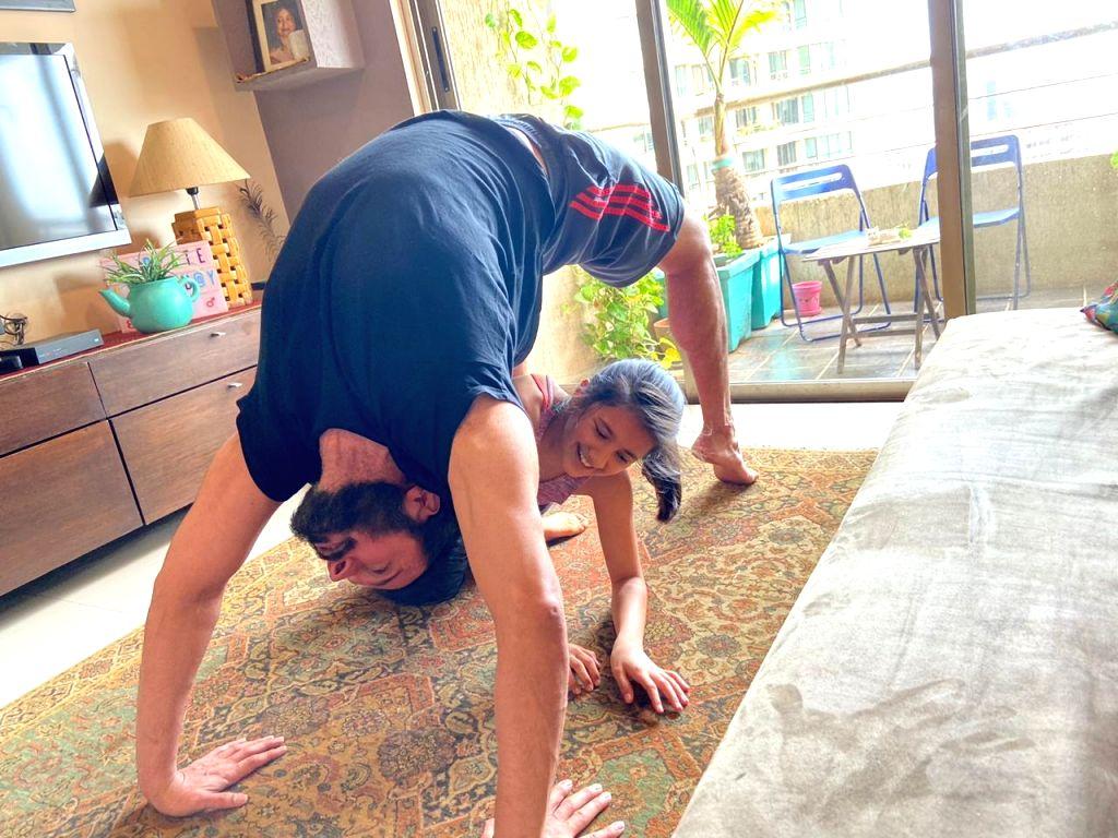 Rajniesh Duggal celebrates Yoga Day with daughter.