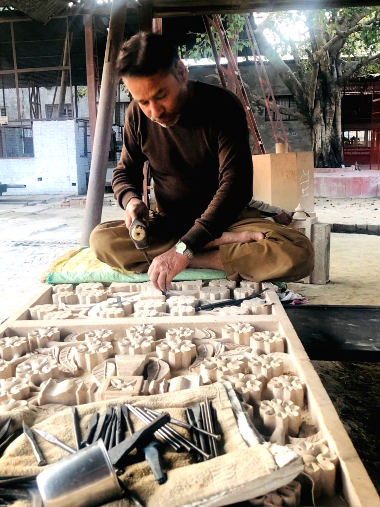 Rajnikant, an artisan from Gujarat working on carving stones for the temple for the last five years.