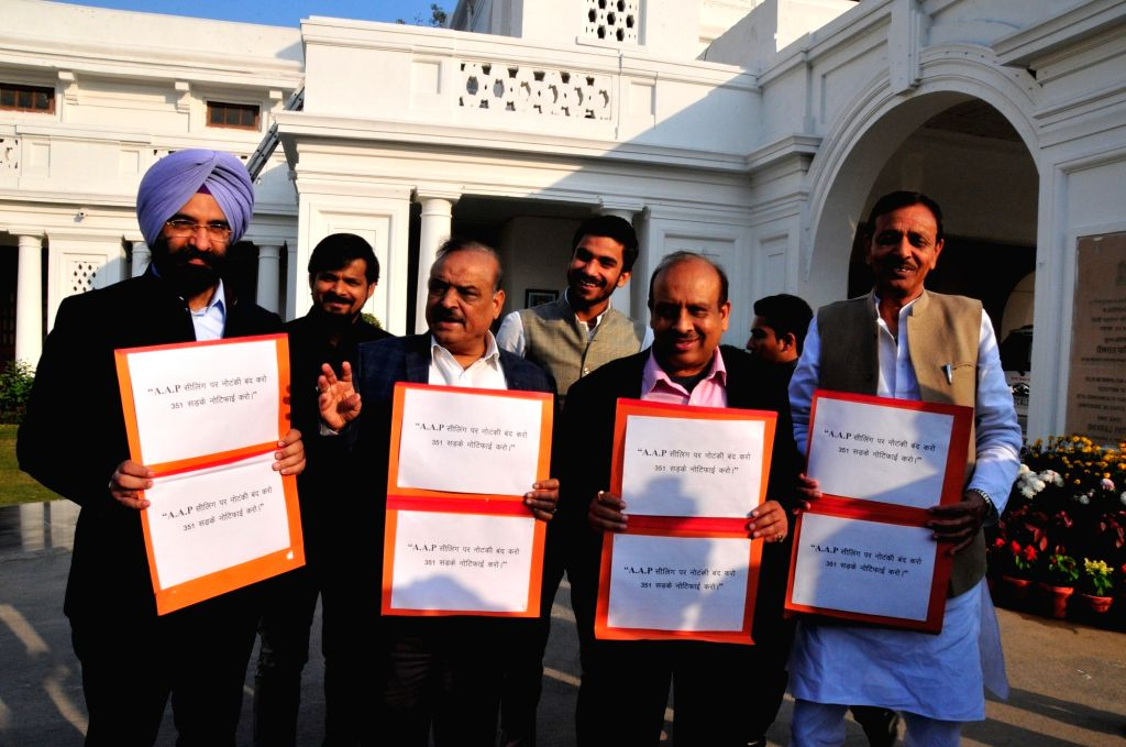 Rajouri Garden MLA Manjinder Singh Sirsa, Vishwas Nagar MLA (BJP) Omprakash Sharma, Mustafabad MLA (BJP) Jagdish Pradhan and Rohini MLA (BJP) Vijendra Gupta stage a demonstration at Delhi Assembly on ... - Manjinder Singh Sirsa, Omprakash Sharma and Vijendra Gupta