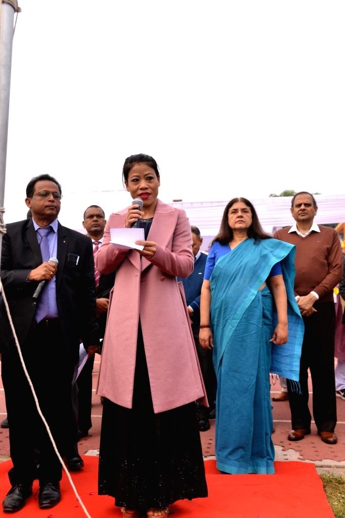 Rajya Sabha MP and Indian Olympic Boxer M.C. Mary Kom accompanied by Union Women and Child Development Minister Maneka Gandhi and Ministry of Women and Child Development Secretary Rakesh ... - Maneka Gandhi and Mary Kom