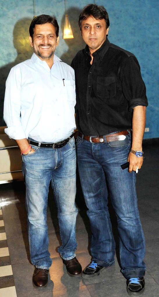 Rakesh Madhotra ceo Nadiadwala grandson with producer director Vikram Razdan during special screening of film 2 States at YRF Studios in Mumbai on April 17, 2014.