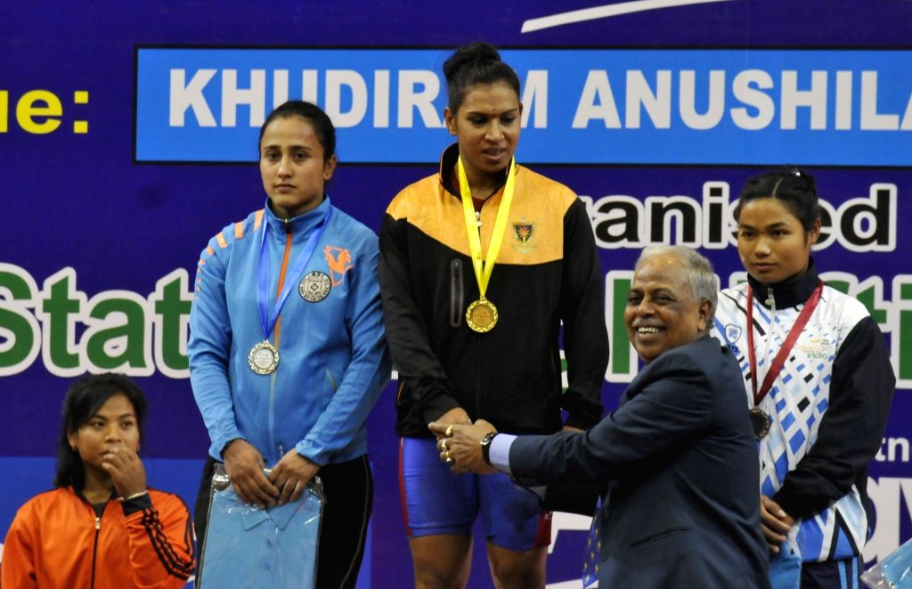 Rakhi Halder being felicitated at a prize distribution ceremony during the Senior National Weight lifting Championship in Kolkata on Feb 5,2020.(Photo :IANS)