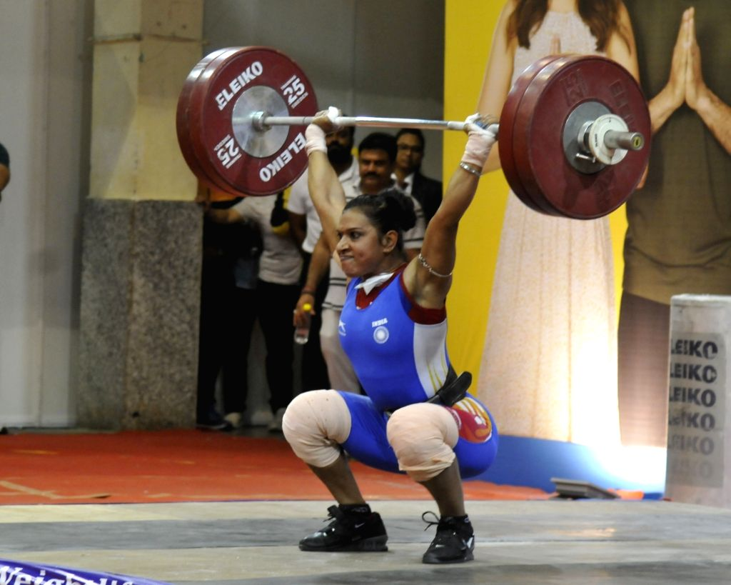 Rakhi Halder performs in the 64 Kg category during the Senior National Weight lifting Championship in Kolkata on Feb 5,2020.(Photo :IANS)