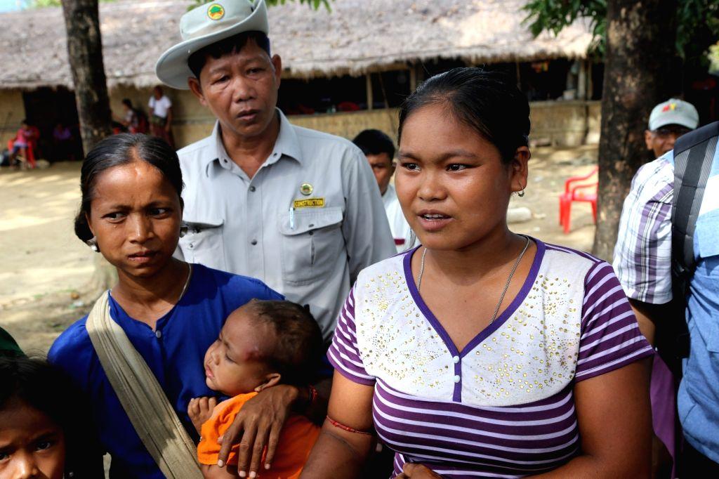 RAKHINE, Oct. 3, 2017 - A villager tells about her suffering in Ah Nauk Pyin Village, Myanmar's northern Rakhine state, on Oct. 2, 2017. Around 50 delegates from embassies, international ...