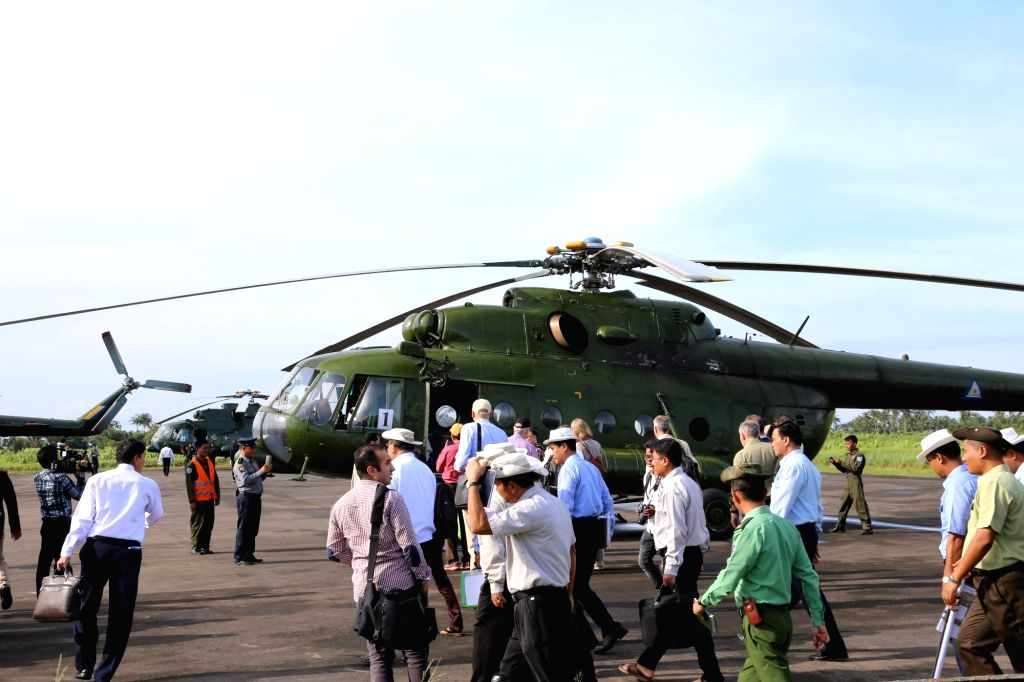 RAKHINE, Oct. 3, 2017 - Delegates board a helicopter at Sittwe Airport in Myanmar's northern Rakhine state, on Oct. 2, 2017. Around 50 delegates from embassies, international organizations and media ...